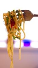 Pasta with grape tomatoes, colatura and garlic